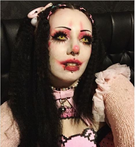 Woman in clown-inpsired pink makeup and outfit